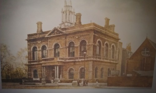 A tinted photograph of the town hall in its early heyday